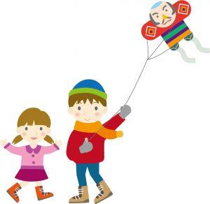 凧揚げをする兄妹
