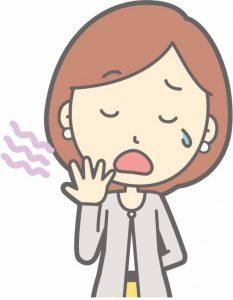 涙を出してあくびをする女性